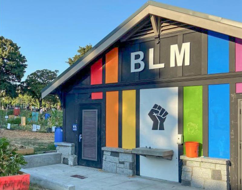 A Black Lives Matter sign painted on a building at Cal Anderson Park